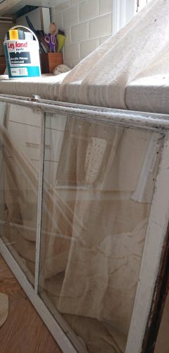 Sash window with brush strip